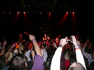 Cowboy Mouth - Cowboy Mouth performing Everybody Loves Jill on Mardi Gras night in Houston, 2010, with fans waving red spoons in anticipation of their cue to throw them at the band.