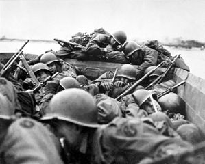 Soldiers from the Division cross the Rhine River in assault boats, 1945. Wikipedia