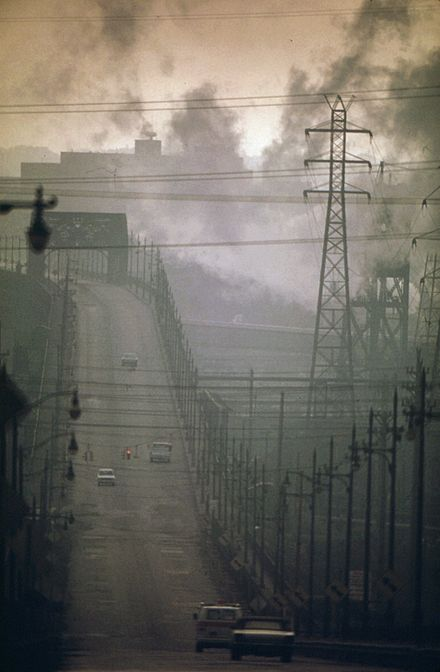 Air pollution in the US, 1973 DARK CLOUDS OF FACTORY SMOKE OBSCURE CLARK AVENUE BRIDGE - NARA - 550179.jpg