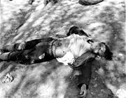Dead German female guard from the Ohrdruf Concentration Camp. She was either killed by the U.S. troops or by the prisoners