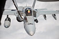 Defense.gov News Photo 100424-F-9429S-376 - A U.S. Navy F A-18 Hornet aircraft is refueled by an Air Force KC-10 Extender aircraft from the 908th Expeditionary Air Refueling Squadron during a.jpg