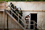 Defense.gov News Photo 120706-M-IX060-001 - Canadian soldiers and a U.S. Marine move in as a fire team to clear a rooftop during an urban operations exercise at Marine Corps Training Area.jpg