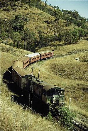 Central Western railway line, Queensland - QR loco 1732 hauls a special train on the Drummond Range section, near Bogantungan, September 1989