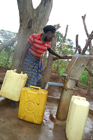 Borehole - A woman in Uganda collects water from a borehole.