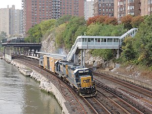 Marble Hill (Metro-North station) - Freight locomotives pass through the station. October 2014.