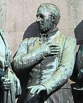 E.M. Arndt als Assistenzfigur am Reiter-Denkmal für Friedrich Wilhelm III. von Preußen auf dem Heumarkt in Köln (Quelle: Wikimedia)