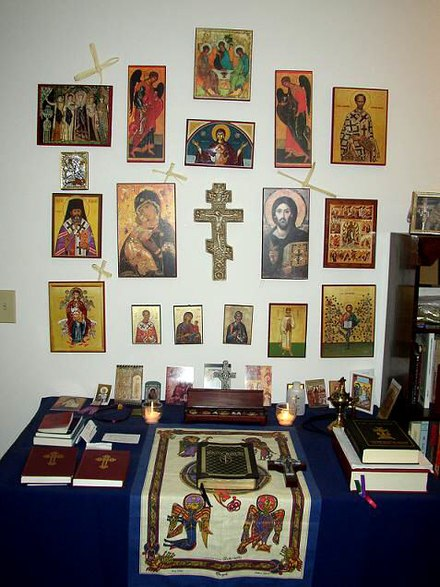 A fairly elaborate Orthodox Christian icon corner as would be found in a private home. Eastern Orthodox prayer corner.jpg