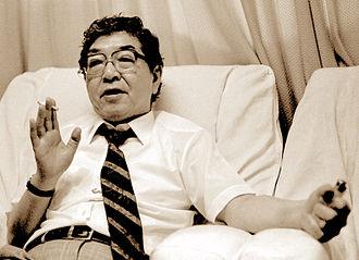 Eikoh Hosoe - Hosoe in his studio discussing Japanese photography, Tokyo 1989