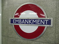 Embankment station District Circle roundel.JPG