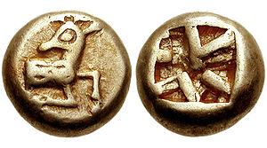 History of coins - Electrum coin from Ephesus, 520-500 BCE. Obverse: Forepart of stag. Reverse: Square incuse punch