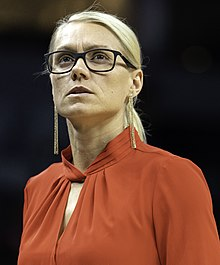 Close-up photo of Phillips wearing glasses while coaching