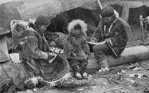 Parka - An Inuit family wearing traditional Caribou parkas
