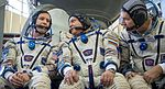 Expedition 50 backup crew members in front of the Soyuz TMA spacecraft mock-up in Star City, Russia.jpg