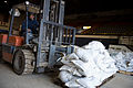 FEMA - 40551 - Volunteers moving sand bags with a lift in North Dakota.jpg