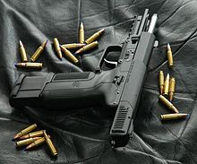 Photo of an all-black Five-seven USG with its slide locked back