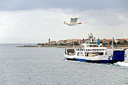 Ferry Zancle approaching Villa San Giovanni - Punta Pezzo lighthouse in the background - 20 Oct. 2010.jpg
