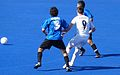 Fletcher of ParalympicsGB competes for the ball against two Argentina players (9375560933).jpg