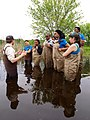 For the Biology Unit, interns hopped into waders and one of the refuge biologists explained how they research and monitor Blanding's Turtles. (7374950292).jpg