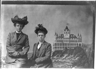 Frances Benjamin Johnston - Frances Benjamin Johnston Collection/LOC cph.3a47220. Frances Benjamin Johnston, with Mattie, with a painted backdrop of the Cliff House in San Francisco, California, 1903