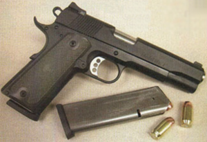 Guncrafter Industries Model No. 1 - A Model No. 1 handgun with a spare magazine and two .50 GI rounds