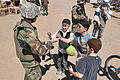 GI gives candy to children during a training exercise -a.jpg