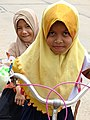 Girls on Bicycle - Cham Muslim Village - Tonle Bet Commune - Kampong Cham - Cambodia (48345361661).jpg
