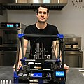 Giuseppe Scionti, with a prototype of his printer in 2019.jpg