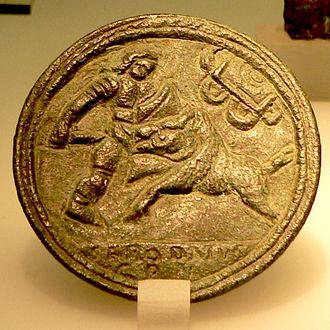 Inaugural games of the Flavian Amphitheatre - A depiction of the venatio on a bronze medallion; a hunter confronts a boar.