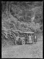 Group with car, Christmas Day, on the Waikanae to Akatarawa Road, Wellington region ATLIB 548155.png