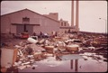 HOUSEHOLD TRASH HAS BEEN DUMPED IN FRONT OF THE NEW YORK CITY INCINERATOR PLANT AT GRAVESEND BAY - NARA - 547868.tif