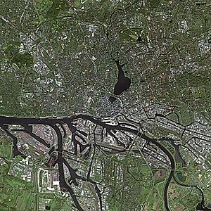 Port of Hamburg - Satellite image of Hamburg. The Port of Hamburg stretches along the Southern shore of the River Elbe and branches into numerous natural river arms.