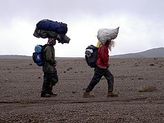 Helpers carrying loads on their heads on Mt Kilimanjaro.JPG