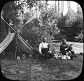 Herman Bohlman and William L. Finley at a campsite along a river (3945318685).jpg