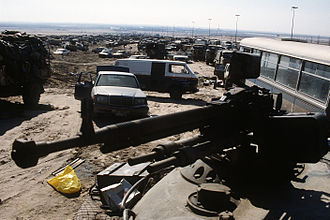 Mutla Ridge - Abandoned vehicles clog the Basra-Kuwait highway out of Kuwait City after the retreat of Iraqi forces, 1991