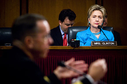 Clinton listens as the Chief of Naval Operations, Admiral Michael Mullen, responds to a question during his 2007 confirmation hearing with the Senate Armed Services Committee Hillary Clinton at the Senate Armed Services Committee.jpg