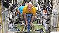 ISS-31 André Kuipers uses a body mass measurement device.jpg