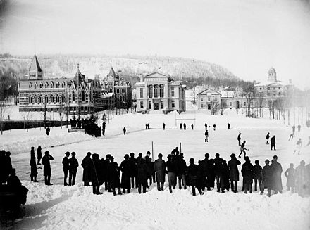 A hockey game on campus in 1884, just seven years after McGill students wrote the then-new game's first rule book, with the Arts Building, Redpath Museum, and Morrice Hall (then the Presbyterian College) visible Ice hockey McGill University 1884.jpg