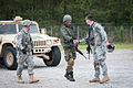 Indian Army Maj. Prashant Mishra is welcomed to a weapons range by Capt. Cullen Lind.jpg