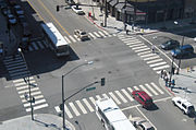 This intersection in San Jose, California has crosswalks, left-turn lanes, and traffic lights.