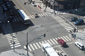 Traffic - This intersection in San Jose, California has crosswalks, left-turn lanes, and traffic lights.