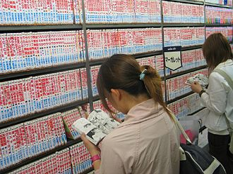 Mariko Aoki phenomenon - Customers standing and reading manga in a Japanese bookstore