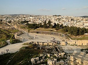 The Greco-Roman city of Gerasa and the modern Jerash in the background.
