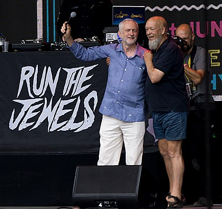 Jeremy Corbyn and Michael Eavis together on the Pyramid Stage at the 2017 Glastonbury Festival Jeremy-Corbyn-Michael-Eavis-Glastonbury-Cropped.jpg