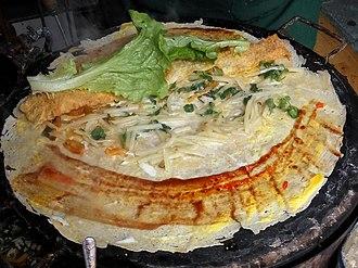 Jianbing - An unwrapped jianbing showing all of the ingredients inside.