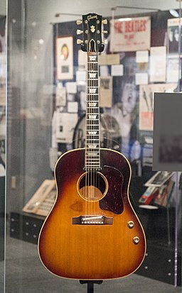 John Lennon's missing 1962 Gibson J-160E guitar in the exhibit (clip3) - Ladies and Gentlemen... the Beatles! exhibit at LBJ Presidential Library, Austin, TX, 2015-06-12 11.37.55