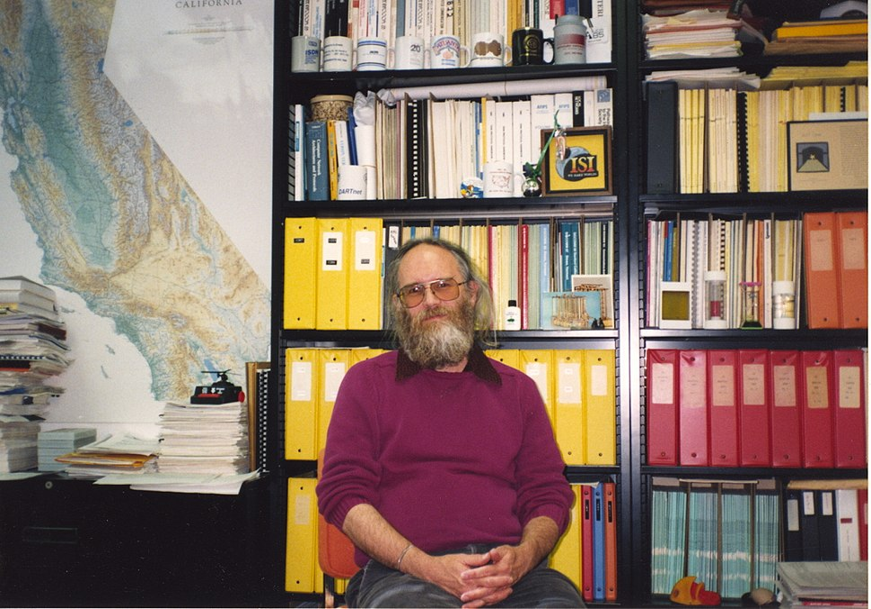 Jon Postel sitting in office