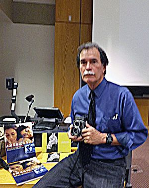 Latinos (newspaper series) - José Galvez with his camera, equipment and books.