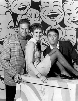 Judy Carne - L-R: Dan Rowan, Judy Carne, and Dick Martin on pilot for Rowan & Martin's Laugh-In (1967)