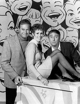 Judy Carne - L-R: Dan Rowan, Judy Carne, and Dick Martin on pilot for Rowan & Martin's Laugh-In (1967)
