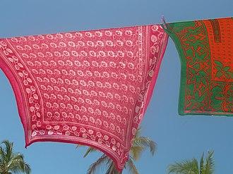 Kanga (African garment) - Kangas drying on a line in Paje, Zanzibar, Tanzania